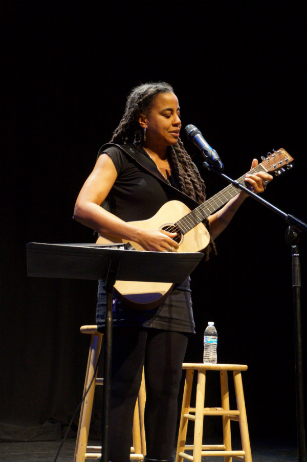 suzan lori-parks with a guitar