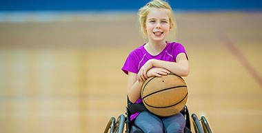 Girl playing Wheelchair Basketball